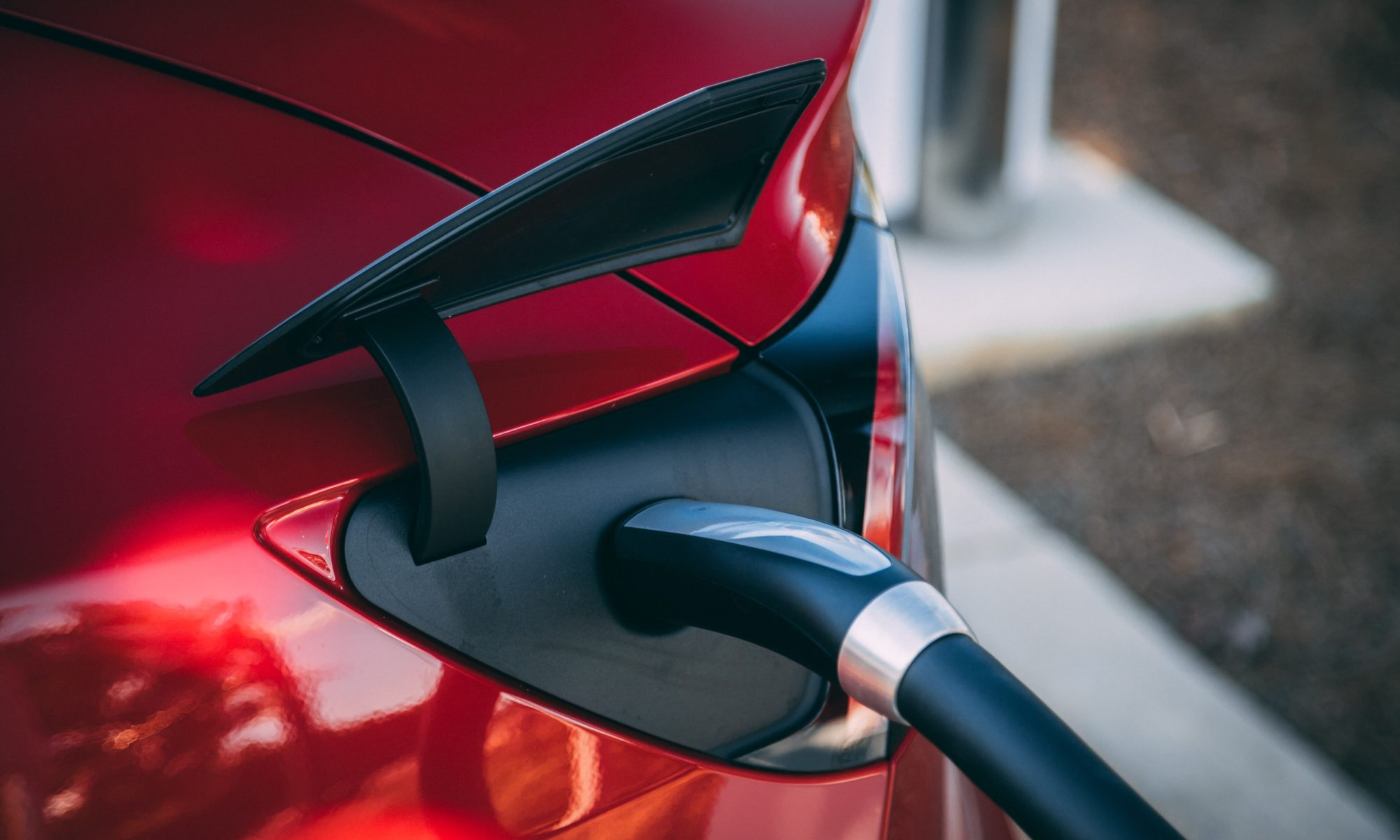 Tesla Model 3 Charging Photo by Vlad Tchompalov on Unsplash